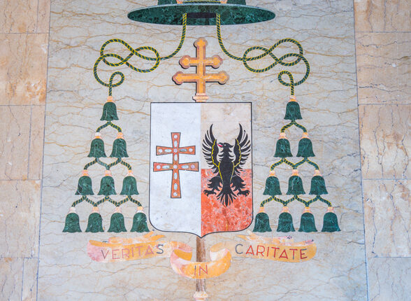 """Veritas in Caritate"" bishop coat of arms in the entrance of the Church of Santa Caterina da Siena a Magnapoli. Rome, Italy."