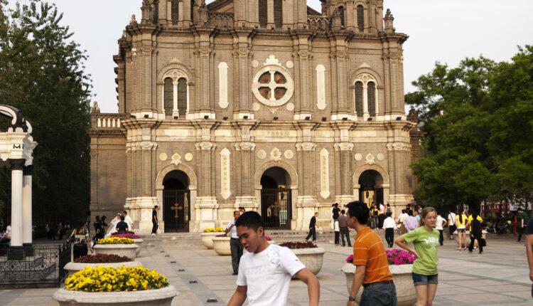 Youths playing in front of Saint Joseph's church in Wangfujing street, Beijing, China.